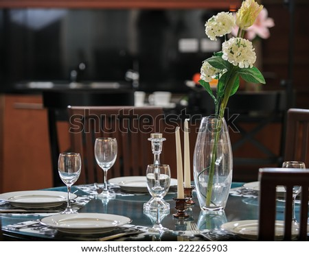 Empty glasses set in restaurant on the table - stock photo