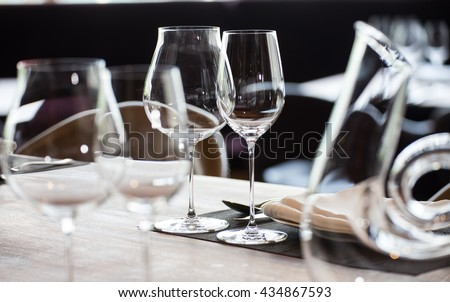 Empty glasses set in restaurant, Setting table in the restaurant, Soft & Dreamy Effect, Low Clarity, for background. - stock photo