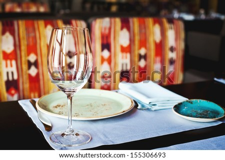 Empty Glasses Set in Restaurant (with plates and napkin) - stock photo