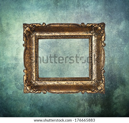 Empty golden frame on grunge old wall - stock photo