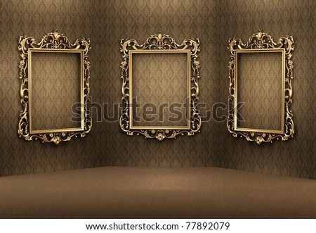 Empty golden frames on the wall in luxurious interior. Royal apartment. Showroom - stock photo
