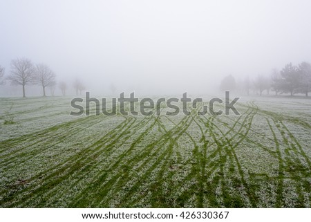 Empty golf course fairway  on a cold and misty  day - stock photo