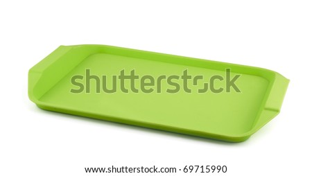 Empty green plastic tray isolated on white - stock photo