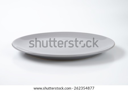 empty grey plate on white plate - stock photo