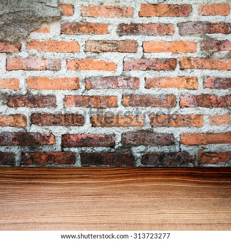 Empty grungy brick wall and wooden floor texture background - stock photo
