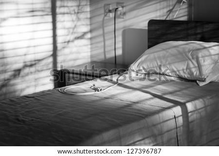 empty hospital bed - stock photo