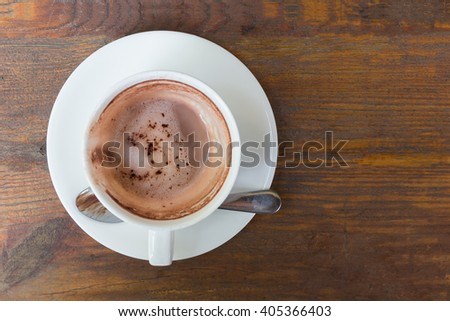 Empty hot coffee cup after drink on wood table. - stock photo