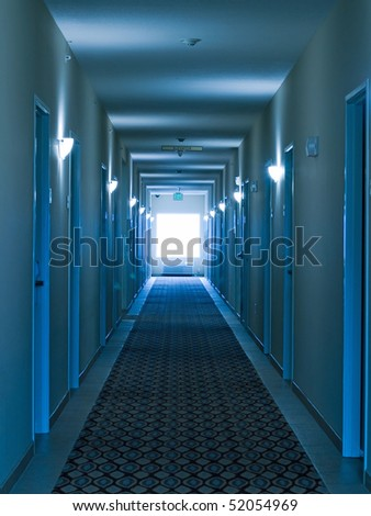 Empty hotel corridor in monochrome blue color tone - stock photo