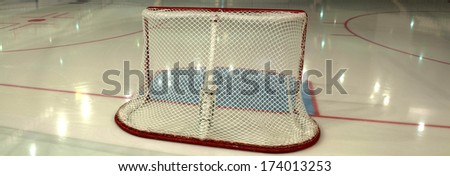 empty ice hockey playground - the view from behind the gate  - stock photo