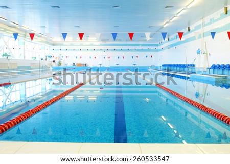 Empty indoors public swimming pool  - stock photo