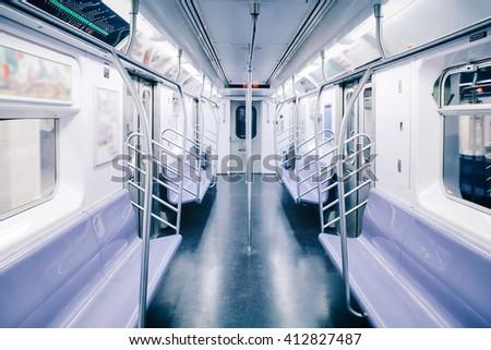 Empty interior inside of the public transport train or subway / metro. - stock photo