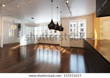 Empty interior residence with hardwood floors in the city  - stock photo