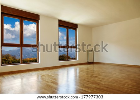 Empty interior room and two windows closed - stock photo