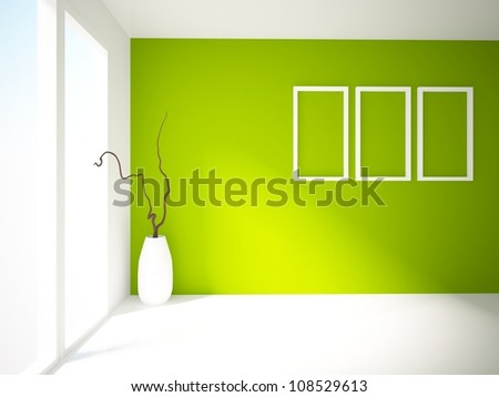 empty interior with a big vase, green wall and white frames on it - stock photo