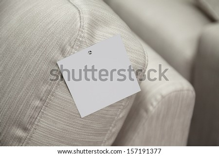 empty label attached to the sofa - stock photo