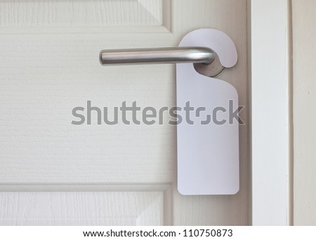 Empty label on a door handle for your text - stock photo