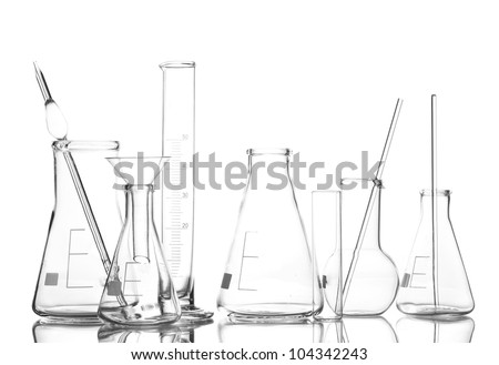 Empty laboratory glassware with reflection isolated on white - stock photo