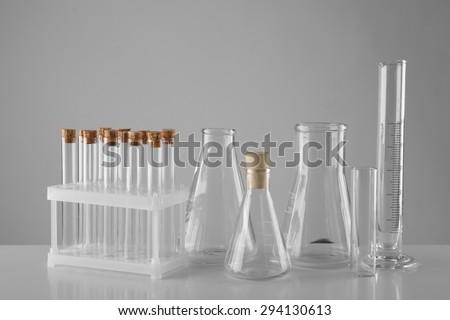 Empty laboratory test tubes  on gray background - stock photo