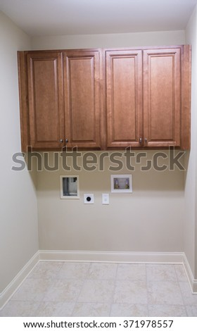 Empty Laundry Room in New Home - stock photo
