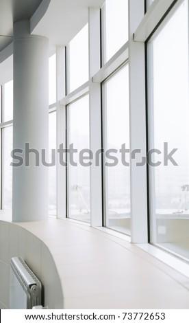 empty light big hall with glass windows - stock photo