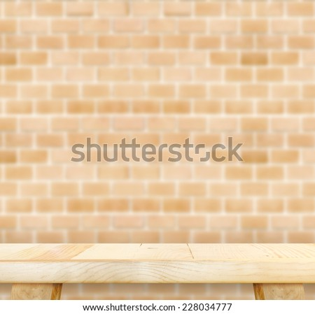 Empty light wood table and blurred orange brick wall background. product display template.Business presentation - stock photo