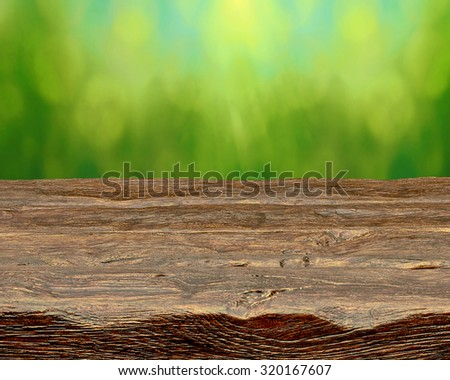 Empty log table with green background   - stock photo
