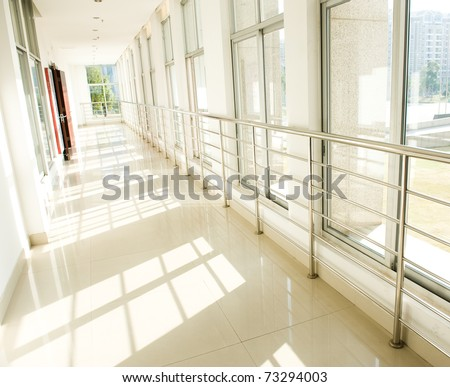 empty long corridor in hospital. - stock photo