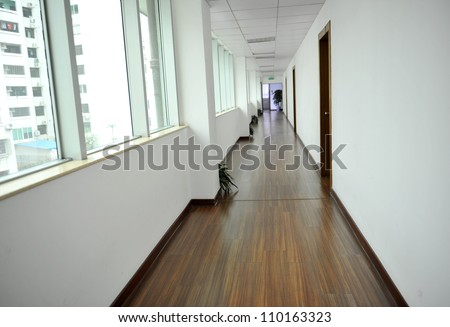 empty long corridor with lots of windows. - stock photo