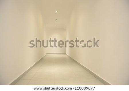 Empty long white corridor, for design. - stock photo