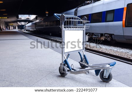 Empty luggage cart on the metro station - stock photo
