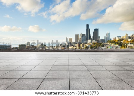 empty marble floor with cityscape and skyline of seattle - stock photo