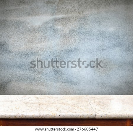 Empty marble table and blue concrete wall in background,product display business template - stock photo