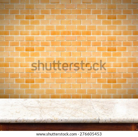 Empty marble table and orange brick wall in background,product display business template - stock photo