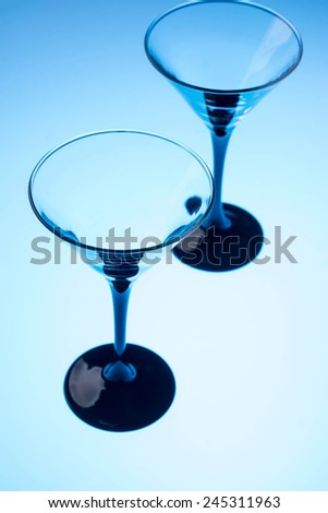 Empty martini glasses on the bar table - stock photo