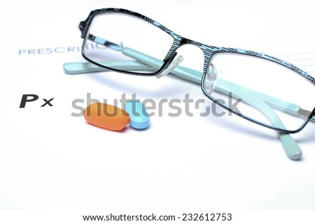 Empty medical prescription with glasses and pills above - stock photo