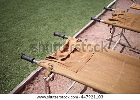 Empty medical stretcher to transport victims - stock photo