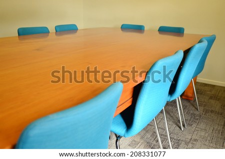 Empty meeting conference table with natural light. Concept photo of business workplace. - stock photo