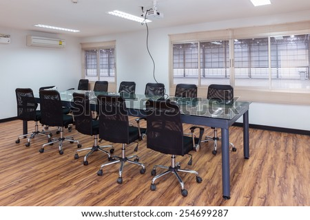 Empty meeting room with  Overhead projector on ceiling at warehouse - stock photo
