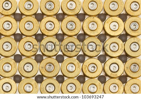 Empty 9mm bullet casings in a row - stock photo