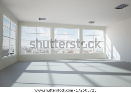 Empty modern office room with urban skyline - stock photo