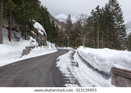 Empty mountain road on a cloudy winter day. Italy - stock photo