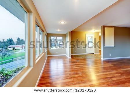Empty new bedroom with many doors and beige carpet. - stock photo