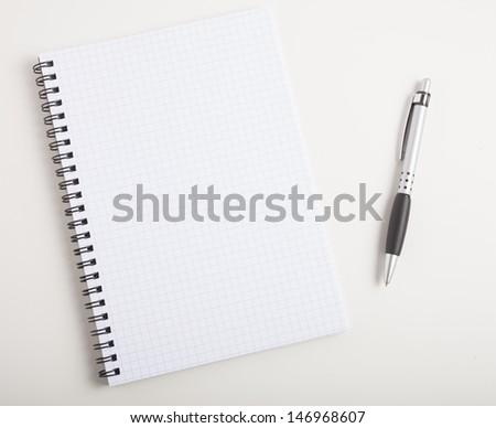 Empty notebook on a desk - stock photo