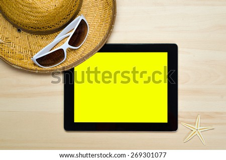 empty notebook on wooden table surface with beach hat, seashells, starfish, sunglasses - stock photo