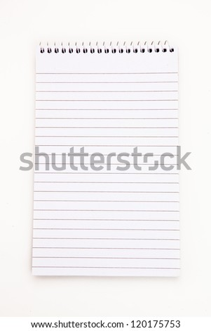 Empty notepad  sheet  against white background - stock photo