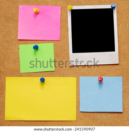 empty notes and photo frame on wooden background - stock photo