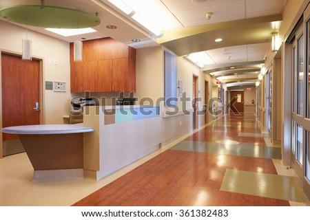 Empty Nurses Station And Corridor In Modern Hospital - stock photo