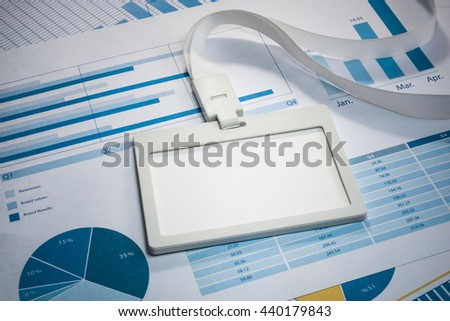 Empty of white Identification card on business paper document graph.For create business concept ideas. - stock photo