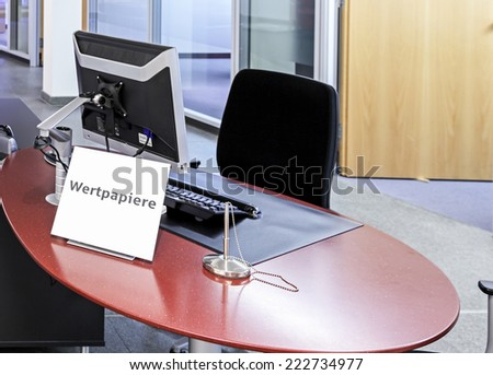"""Empty office of broker with sign """"Wertpapiere"""" written on it standing on desk - stock photo"""