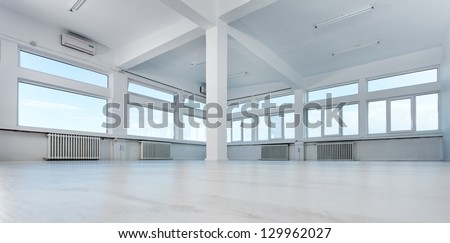 Empty office space with large windows - stock photo